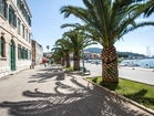 Promenade with palm trees in Vela Luka.